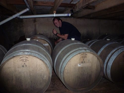 Chris, Bruce's son taking a small sample of some ancient sherry for Harriet on her recent visit there.